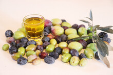Olive Oil With Olives On White Background. Freashly Gathered, Raw And Organic.