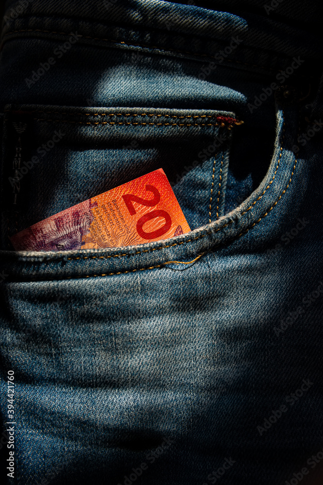 Fototapeta Twenty Swiss francs paper note in jeans pocket.