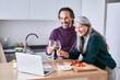 Leinwandbild Motiv Couple making video call on laptop