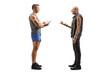 Leinwandbild Motiv Full length profile shot of a punk man talking to a male fitness trainer