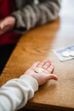 Hand Holding Coin, Sweden