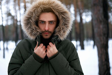 Attractive Bearded Man Standing Outdoors In Winter Season Forest.