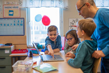Teacher Helping Children In Classroom, Sweden