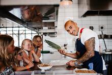 Smiling Chef In Restaurant Kitchen, Sweden