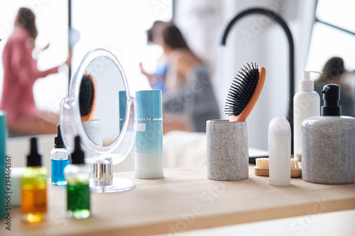 Face care bottles on wooden counter table
