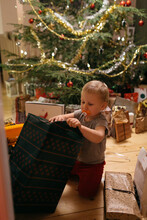 Toddler Opening Christmas Present, Sweden