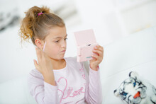 A Schoolgirl Holding Electronic Game