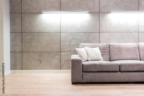 Fotografie, Obraz Empty sofa against illuminated wall in apartment