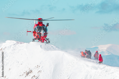 Tela A rescue helicopter landing in the snow Swiss alps