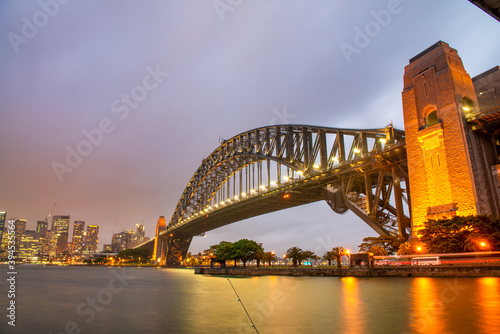 Sydney Harbour Bridge at night and city skyline © jovannig