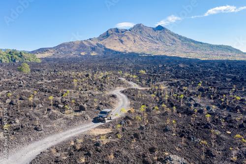 Off road vehicle descende slopes of Batur volcano Canvas