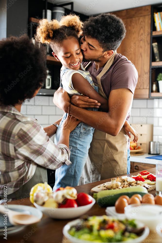 Leinwandbild Motiv - NDABCREATIVITY : Happy family preparing healthy food in kitchen together