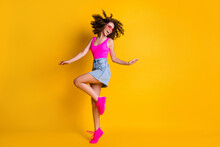 Full Body Photo Of Attractive Youngster Curly Lady Dance Disco Students Party Skinny Figure Wear Sun Specs Pink Tank Top Denim Mini Skirt Shoes Isolated Vivid Bright Yellow Color Background