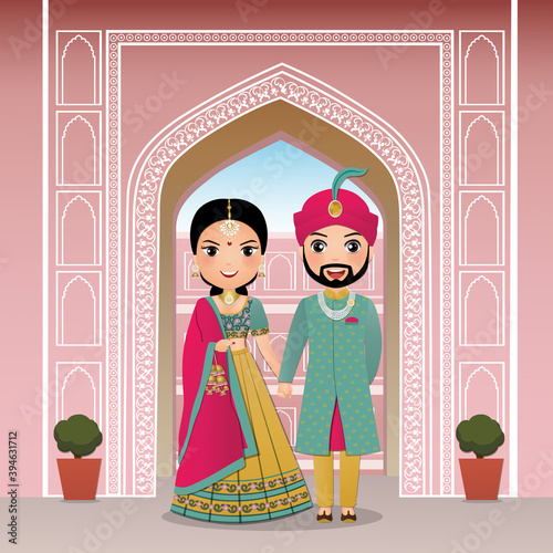 Foto Wedding invitation card the bride and groom cute couple in traditional indian dress cartoon character