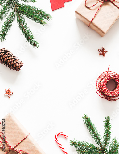 Christmas composition. Christmas gifts, fir tree branches, decorations on white background. Flat lay, top view