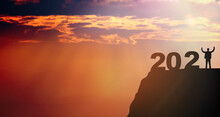 Silhouette Doctor Raised Hand Success Between 2020 And 2021 Years With Sunset Sky Background.Fight Covid19 Pandemic With Hope.Happy New Year 2021.Vaccine Success.New Normal New Year.banner Background.
