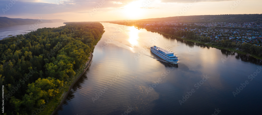 Fototapeta Panorama of the cruise ship moving on the river of Volga towards Samara city in Russia