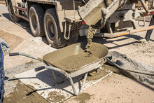 Concrete In A Hand Wheelbarrow From A Concrete Mixer
