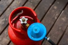 Old Gas Cylinder On The Wooden Floor. Selective Focus. Closeup