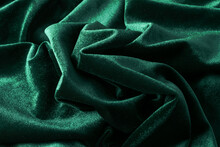 Draped Velvet Fabric In Trendy Green Color. Abstract Modern Background