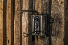 Close Up Of Vintage Key On Wooden Cellar Door