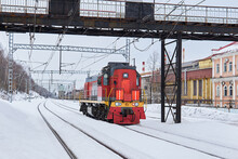 Shunting Locomotive On A Railway Track In An Industrial Area On A Winter Day