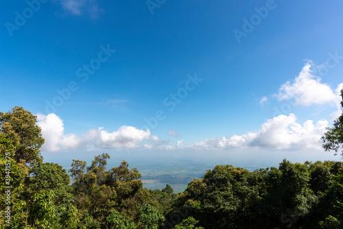 Fotografie, Obraz Beautiful landscape cloud with blue sky at Camping area on the top of Khao Luang Sukhothai  ,Ramkhamhaeng National Park ,Sukhothai Thailand