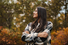 Beautiful Happy Woman Smiling While Strolling In Autumn Forest