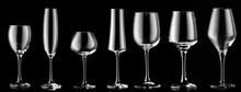 Different Empty Glasses On Dark Background