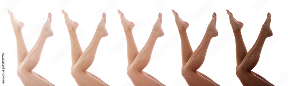 Legs of beautiful young woman on white background