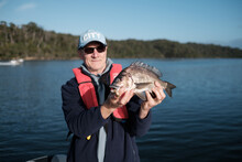 Man Holding A Southern Black Bream He Caught