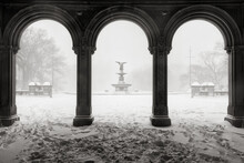 Black & White View Of The Bethesda Fountain From The Bethesda Terrace Arcade During A Winter Snowstorm. Central Park, Manhattan, New York City