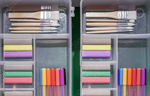 Fotomural Plastic pencil cases with colored crayons, brushes and felt-tip pens