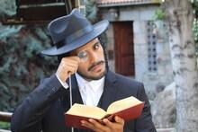 Jewish Man Using Magnifying Glass