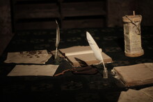 Close-up Of Old Books With Quills