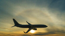 Silhouette Of A Flying Plane O...