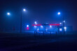 Night gas station in the fog