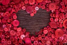 Full Frame Shot Of Buttons Arranged In Heart Shape On Table