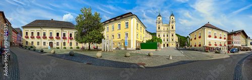 Fotografering Panorama view of beautiful and colourful village Mondsee in Austria