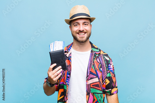 Photographie young man looking happy and pleasantly surprised, excited with a fascinated and