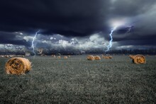 Thunderstorm Over Agricultural Field Against Sky