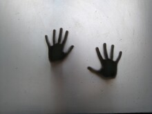Cropped Hands Of Person Hand On Glass Window