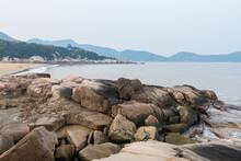Rocky Coastline And Rocks And Beach In The Putuoshan, Zhoushan Islands,  A Renowned Site In Chinese Bodhimanda Of The Bodhisattva Avalokitesvara (Guanyin)