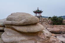 A Chinese Traditional Pavilion And Rocks In The Putuoshan, Zhoushan Islands,  A Renowned Site In Chinese Bodhimanda Of The Bodhisattva Avalokitesvara (Guanyin)
