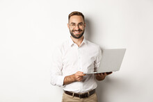 Business. Sucessful Businessman Working With Laptop, Using Computer And Smiling, Standing Over White Background