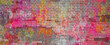 Banner multicolored brick wall. Bright pink yellow and white paint on brick texture.