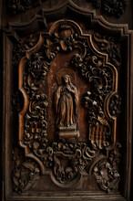 Carved Door Panel On Front Door Of San Agustin Church In Manila