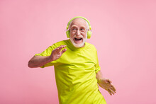 Photo Of Crazy Old Man Listen Music Dance Wear Headphones Spectacles Lime Clothes Isolated On Pastel Pink Background