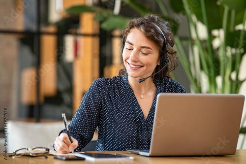 Obraz Successful customer service representative using laptop at office - fototapety do salonu