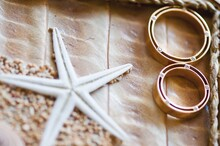 Wedding Rings And Starfish In Tray